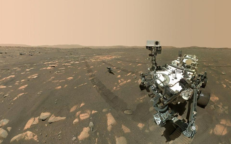 Nasa's Perseverance Mars rover took a selfie with the Ingenuity helicopter, seen here about 13 feet (3.9 meters) from the rover - Nasa