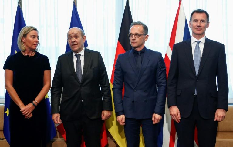 L-R: The diplomatic chiefs of the EU, France, Germany and Britain, pictured in May 2019, urged Iran to reverse its decision to breach a limit on enriched uranium reserves under a 2015 nuclear deal