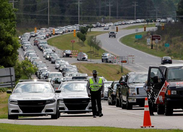 PHOTO: Hundreds of cars line up as mourners arrive for the public viewing of George Floyd, who died in police custody in Minneapolis, in the town where he was born in Raeford, North Caroline, June 6, 2020. (Jonathan Drake/Reuters)
