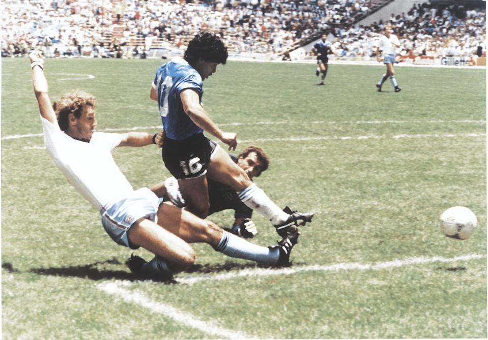 MEXICO CITY, MEXICO - JUNE 22: Diego Maradona of Argentina kicks the ball to score the second goal of his team during a 1986 FIFA World Cup Quarter Final match between Argentina and England at Azteca Stadium on June 22, 1986 in Mexico City, Mexico. (Photo by Archivo El Grafico/Getty Images)