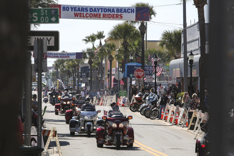 Bikers ride up and down Main Street in Daytona, Fla., during the starting day of Bike Week on Friday, March 5, 2021. (Sam Thomas/Orlando Sentinel via AP)