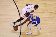 Draymond Green #23 of the Golden State Warriors is defended by Kyle Lowry #7 of the Toronto Raptors in the first half during Game Five of the 2019 NBA Finals at Scotiabank Arena on June 10, 2019 in Toronto, Canada. (Photo by Gregory Shamus/Getty Images)