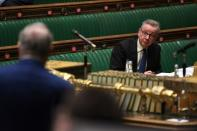 Britain's Chancellor of the Duchy of Lancaster Michael Gove looks on during a debate at the House of Commons in London