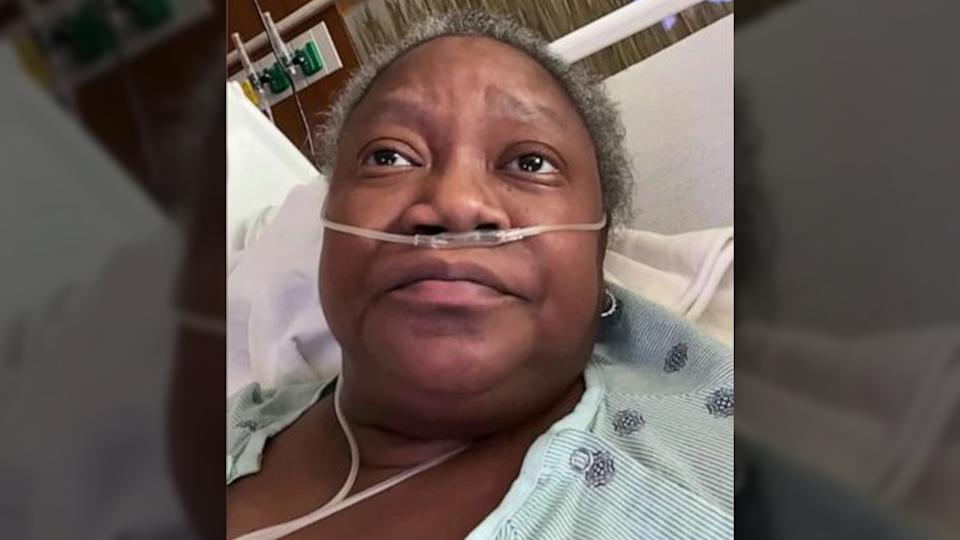 Susan Moore in a hospital bed with oxygen tube