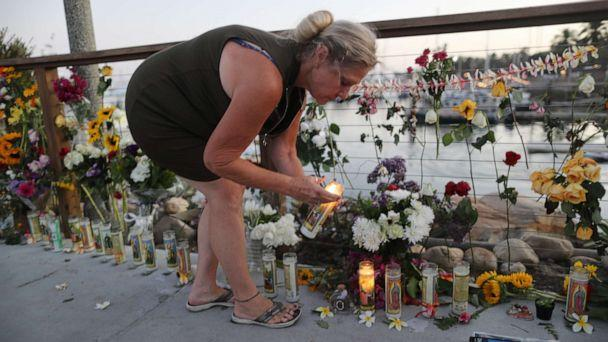 PHOTO: A woman lights a candle in Santa Barbara Harbor at a makeshift memorial for victims of the Conception boat fire on Sept. 3, 2019 in Santa Barbara, Calif. (Mario Tama/Getty Images)