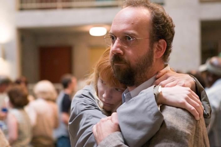 """Story (Bryce Dallas Howard, left) is protected by Cleveland (Paul Giamatti in """"Lady in the Water."""""""