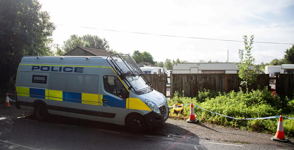 Police officers and forensic teams at a travellers' camp near the scene in Sulhamstead, Berkshirewhere PC Andrew Harper was tragically killed on Thursday. (SWNS)