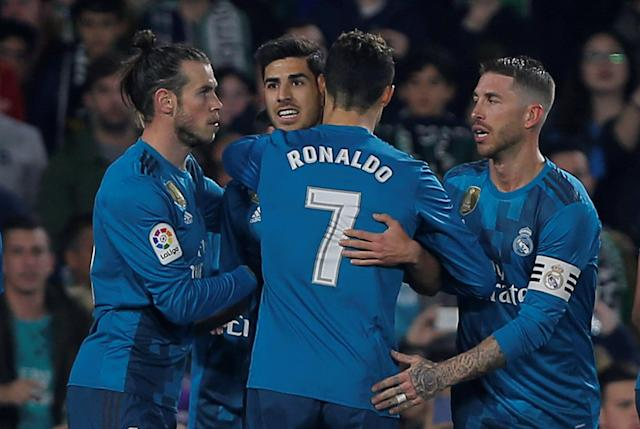 Soccer Football - La Liga Santander - Real Betis vs Real Madrid - Estadio Benito Villamarin, Seville, Spain - February 18, 2018 Real Madrid's Marco Asensio celebrates scoring their first goal with Cristiano Ronaldo, Gareth Bale and Sergio Ramos REUTERS/Jon Nazca