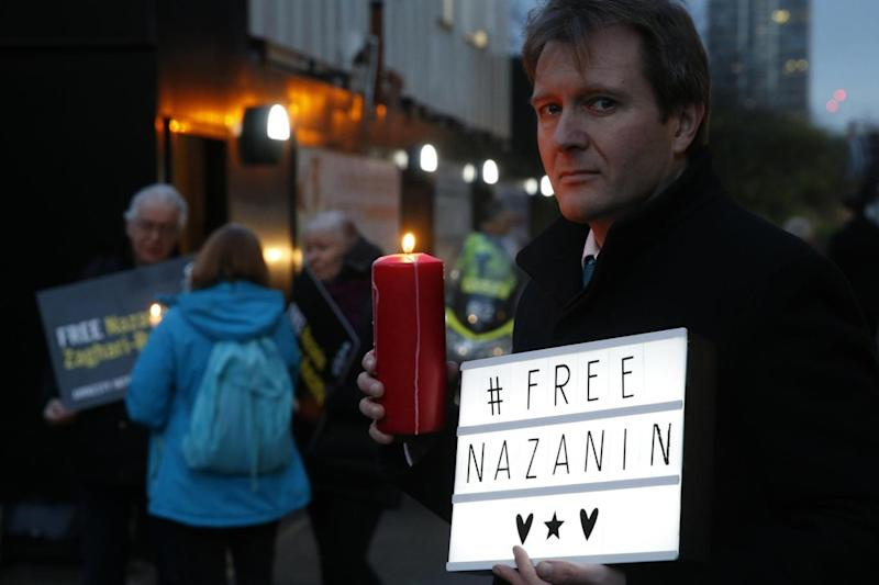 Campaign: Richard Ratcliffe poses for the media during an Amnesty International led vigil outside the Iranian Embassy in London (AP)