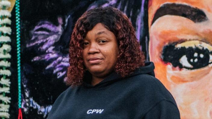 Tamika Palmer, the mother of Breonna Taylor, is shown in front of a mural of her daughter in Louisville, Kentucky's Jefferson Square Park. Taylor was fatally shot by Louisville Metro Police officers in her apartment in March. (Photo by Brandon Bell/Getty Images)