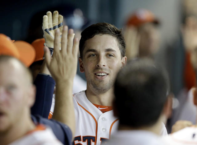 Houston Astros' Jason Castro, center is congratulated in the dugout after hitting a two-run home run against the Boston Red Sox in the third inning of a baseball game Saturday, July 12, 2014, in Houston. (AP Photo/Pat Sullivan)