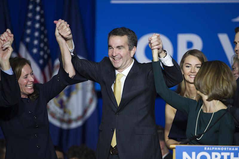Virginia Gov.-elect Ralph Northam celebrates his election victory with his wife, Pam, and daughter Aubrey, right, and Dorothy McAuliffe, wife of Virginia Gov. Terry McAuliffe at the Northam For Governor election night party at George Mason University in Fairfax on Nov. 7, 2017.