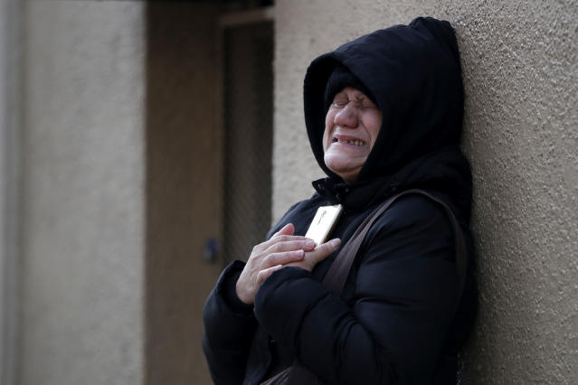 <p>Nilda Guerrero, a friend of the superintendent of an apartment apartment building where a dozen people died in a fire a day earlier in the Bronx, New York, cries after trying to visit the building Friday, Dec. 29, 2017. (Photo: Julio Cortez/AP) </p>