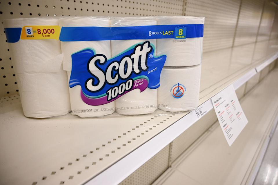 A package of toilet paper sits on an otherwise empty shelf in the paper products aisle of a store in Burbank, California, on November 19, 2020. (Photo by Robyn Beck / AFP)