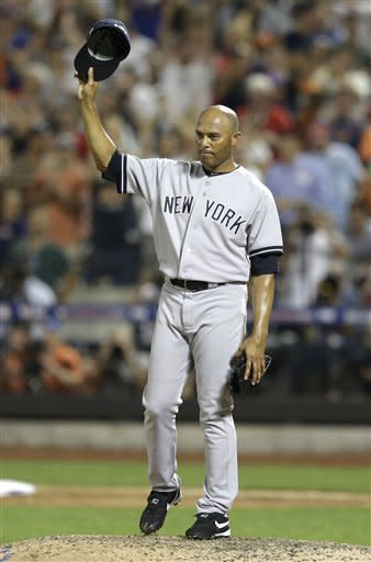 American League's Mariano Rivera, of the New York Yankees, acknowledges a standing ovation during the eighth inning of the MLB All-Star baseball game, on Tuesday, July 16, 2013, in New York. (AP Photo/Kathy Willens)