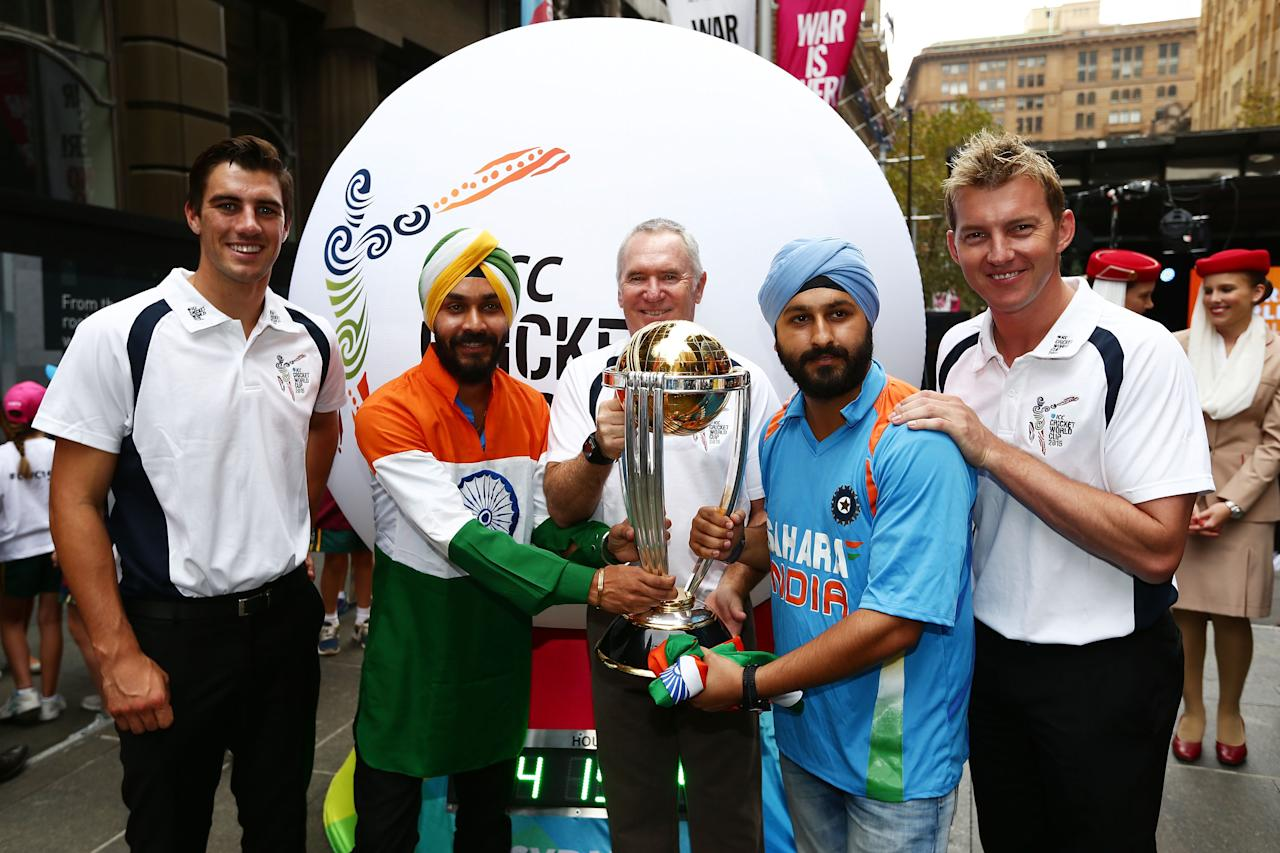 SYDNEY, AUSTRALIA - FEBRUARY 14:  Australian cricketers Pat Cummins (L) and Brett Lee (R) and former Australian cricket captain Allan Border (C) pose with the ICC Cricket World Cup during the media opportunity as the one year to go countdown begins until the 2015 ICC Cricket World Cup at  on February 14, 2014 in Sydney, Australia.  (Photo by Matt King/Getty Images for the ICC)