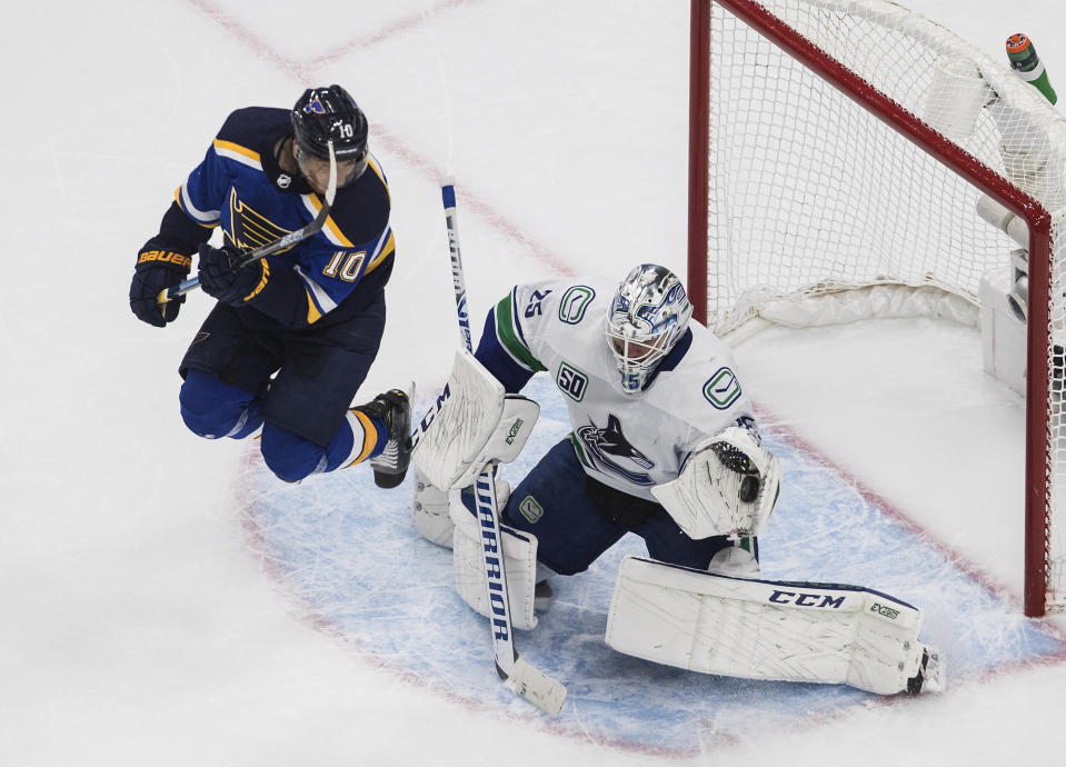 Vancouver Canucks goalie Jacob Markstrom (25) makes a save as St. Louis Blues' Brayden Schenn (10) jumps during the second period in Game 1 of an NHL hockey Stanley Cup first-round playoff series, Wednesday, Aug. 12, 2020, in Edmonton, Alberta. (Jason Franson/The Canadian Press via AP)