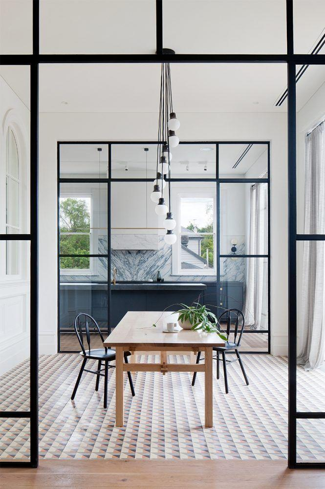 "<p>This space designed by Hecker Guthrie is a happy medium between an <a href=""https://www.housebeautiful.com/lifestyle/fun-at-home/a26570217/why-i-hate-open-floor-plans/"" rel=""nofollow noopener"" target=""_blank"" data-ylk=""slk:open floor plan"" class=""link rapid-noclick-resp"">open floor plan</a> and a closed/ split floor plan thanks to the interior glass doors framing the dining room. The dramatic effect is amplified by the light fixture over the dining table, which also helps transition the kitchen to the rest of the space. </p>"