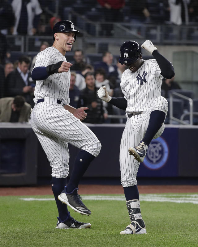 New York Yankees' Didi Gregorius, right, celebrates with Aaron Judge after hitting Gregorius hit two-run home run against the Minnesota Twins during the fifth inning of a baseball game Tuesday, April 24, 2018, in New York. (AP Photo/Julie Jacobson)