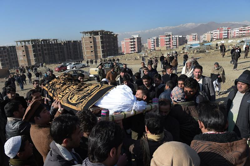 Mourners carry the coffin of one of the 36 victims of twin Taliban blasts the previous day, in Kabul on January 11, 2017
