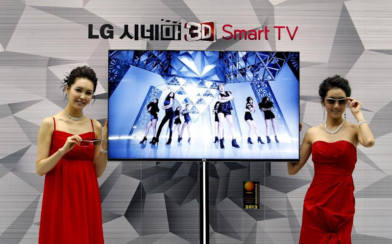 "FILE - In this Thursday, Jan. 19, 2012, file photo, South Korean models pose with a CINEMA 3D Smart TV during a press conference to introduce the LG Electronics' television and the company's marketing strategy for 2012 in Seoul, South Korea.  Hewlett-Packard said Monday, Feb. 25, 2013,  it is selling its webOS operating system technology to South Korea's LG Electronics Inc. for an undisclosed sum. Hewlett Packard Co. and LG said on Monday that LG will use webOS to support its ""smart TV"" technology. (AP Photo/Ahn Young-joon)"