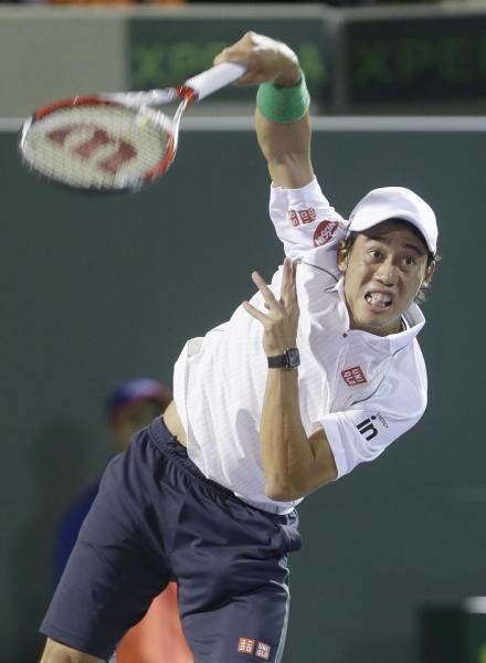 Kei Nishikori of Japan, serves to Roger Federer of Switzerland, at the Sony Open Tennis tournament, Wednesday, March 26, 2014 in Key Biscayne, Fla. (AP Photo/Wilfredo Lee)