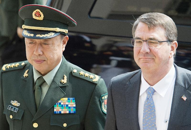 Chinese Gen. Fan Changlong Vice Chairman of China's Central Military Commission, arrives at the Pentagon on June 11, 2015, and stands with US Secretary of Defense Secretary Ashton Carter(R) in Washington, DC