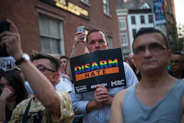 <p>People observe a moment of silence after victims names' were read during a memorial service and rally for the victims of the 2016 Pulse nightclub shooting, down the street from the historic Stonewall Inn June 12, 2017 in New York City. Monday marks the one year anniversary of the Pulse nightclub shooting in Orlando, Florida that killed 49 people. (Photo: Drew Angerer/Getty Images) </p>