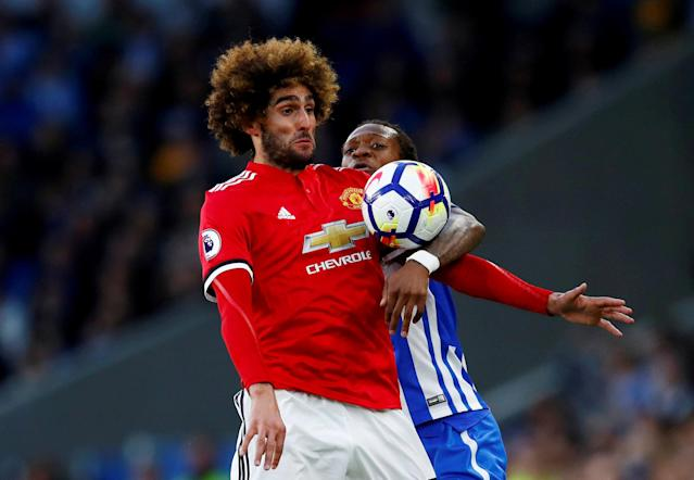 "FILE PHOTO: The American Express Community Stadium, Brighton, Britain - May 4, 2018 Manchester United's Marouane Fellaini in action with Brighton & Hove Albion's Gaetan Bong REUTERS/Eddie Keogh/File Photo EDITORIAL USE ONLY. No use with unauthorized audio, video, data, fixture lists, club/league logos or ""live"" services. Online in-match use limited to 75 images, no video emulation. No use in betting, games or single club/league/player publications. Please contact your account representative for further details."