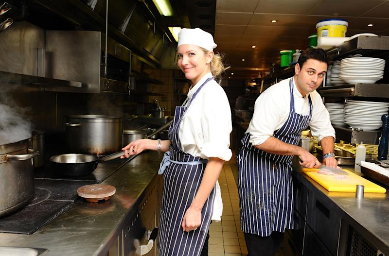Lisa Faulkner, Celebrity MasterChef winner 2010 and Dhruv Baker, Masterchef winner 2010, cooking at the MasterChef Pop Up restaurant at Meza, Soho. (Photo by Ian West/PA Images via Getty Images)