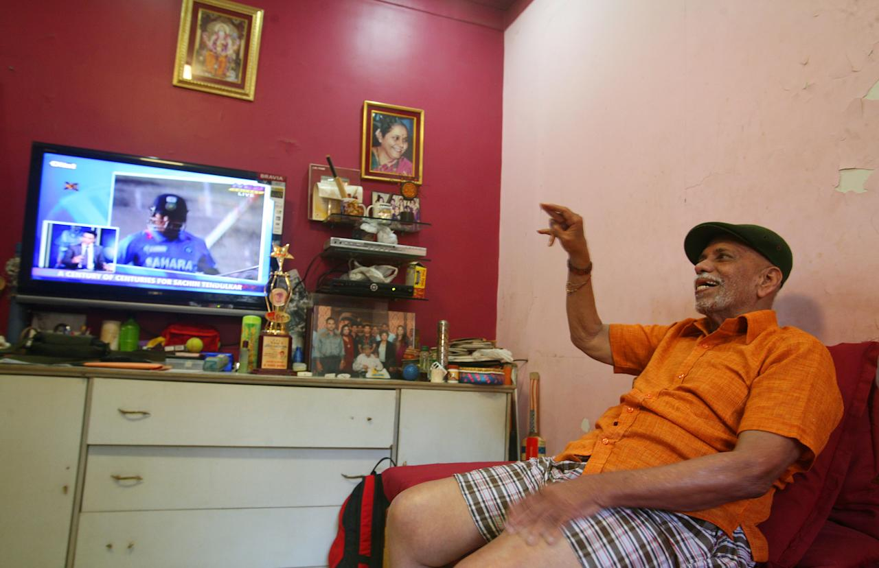 MUMBAI, INDIA - MARCH 16: Ramakant Acharekar, 80, from whom Sachin Tendulkar learnt cricket, watches news on tv of Sachin Teldulkar of India scoring his 100th century in international cricket, at his residence in Shivaji Park on March  16, 2012 in Mumbai, India. Sachin Tendulkar become the first man in the world to score a century of centuries in international cricket during the One Day International (ODI) Asia Cup cricket match between Bangladesh and India at the Sher-e-Bangla National Cricket Stadium in Dhaka today. It became more special as it comes after a gap of 33 innings and one year of agonising waiting for his fans all across the world. Tendulkar has scored 51 Test centuries and 49 One Day centuries.  (Photo by Kalpak Pathak /Hindustan Times via Getty Images)