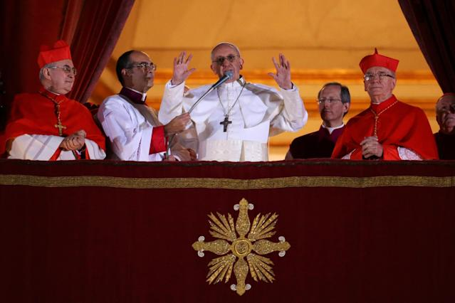 VATICAN CITY, VATICAN - MARCH 13: Newly elected Pope Francis I speaks to the waiting crowd from the central balcony of St Peter's Basilica on March 13, 2013 in Vatican City, Vatican. Argentinian Cardinal Jorge Mario Bergoglio was elected as the 266th Pontiff and will lead the world's 1.2 billion Catholics. (Photo by Peter Macdiarmid/Getty Images)