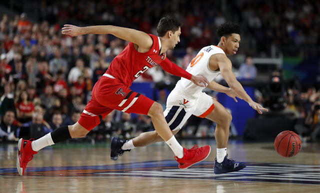Virginia's Kihei Clark (0) drives against Texas Tech's Davide Moretti (25) during the first half in the championship of the Final Four NCAA college basketball tournament, Monday, April 8, 2019, in Minneapolis. (AP Photo/Jeff Roberson)
