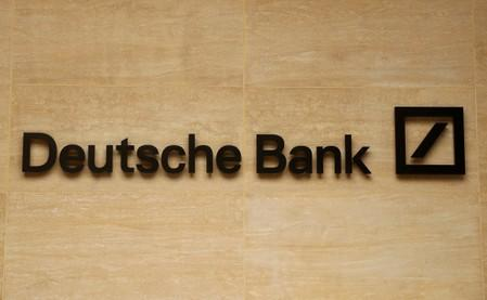 FILE PHOTO: The logo of Deutsche Bank is pictured on a company's office in London