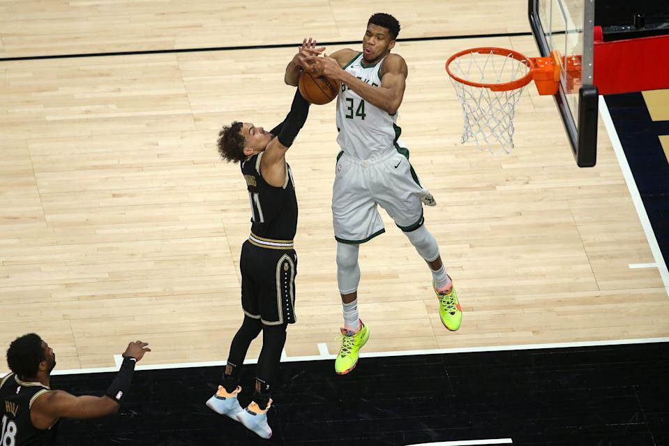 The Hawks and Trae Young will face a tall order in trying to get past Giannis Antetokounmpo (34) and the Bucks.
