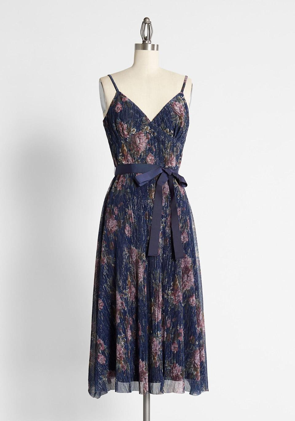 <p>The timeless <span>Glistening to Floral Dreams Midi Dress</span> ($179) is stunning for any big event. </p>