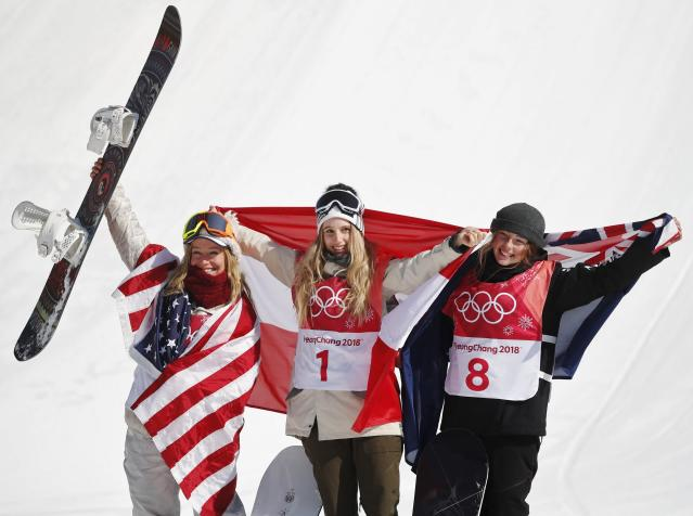 Snowboarding - Pyeongchang 2018 Winter Olympics - Women's Big Air Final Run 3 - Alpensia Ski Jumping Centre - Pyeongchang, South Korea - February 22, 2018 - Gold medallist Anna Gasser of Austria flanked by silver medallist Jamie Anderson of the U.S. and bronze medallist Zoi Sadowski-Synnott of New Zealand hold their national flags during the flower ceremony. REUTERS/Kim Hong-Ji
