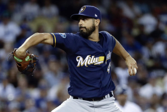 FILE - In this Oct. 16, 2018, file photo, Milwaukee Brewers starting pitcher Gio Gonzalez throws during the first inning of Game 4 of the National League Championship Series baseball game against the Los Angeles Dodgers in Los Angeles. A person familiar with the negotiations tells The Associated Press that left-hander Gonzalez and the New York Yankees have agreed to a minor league contract. The person spoke on condition of anonymity Monday, March 18, 2019, because the agreement had not yet been announced. (AP Photo/Matt Slocum, File)