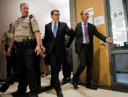 Texas Governor Perry enters the booking area at the Travis County courthouse in Austin, Texas