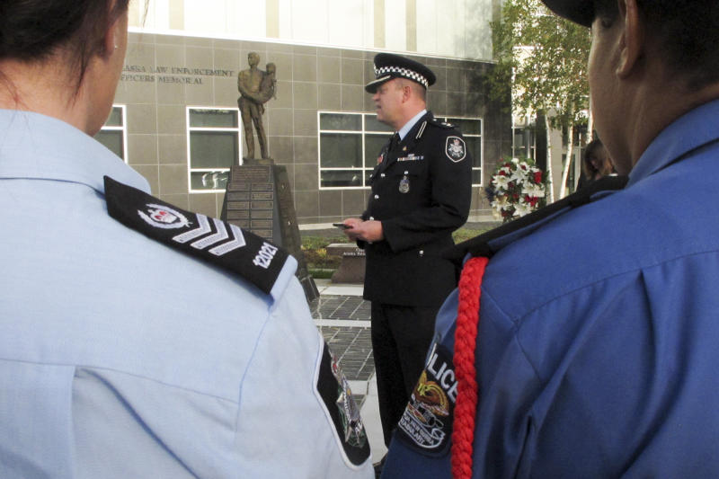 Superintendent Conrad Jensen of the Australian Federal Police speaks at a police remembrance ceremony Friday, Sept. 27,  2019, in Anchorage, Alaska. Jensen was among Australian delegates attending an international police convention who observed their region's fallen officers in the quickly planned ceremony with their Alaska counterparts. (AP Photo/Rachel D'Oro)