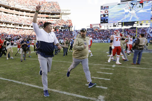 Tennessee Titans head coach Mike Vrabel runs off the field after an NFL football game against the Kansas City Chiefs Sunday, Nov. 10, 2019, in Nashville, Tenn. The Titans won 35-32. (AP Photo/James Kenney)