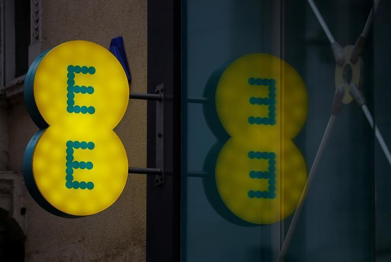 Signage is seen outside an EE mobile phone shop in Manchester