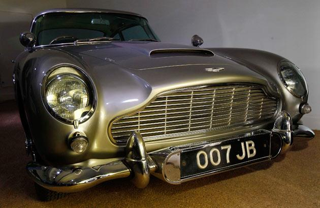 """An Aston Martin DB5 from the James Bond film """"Goldfinger"""" is displayed at the opening of the """"Bond in Motion: 50 Vehicles 50 Years"""" exhibition at the National Motor Museum in Beaulieu, southern England January 15, 2012.    REUTERS/Suzanne Plunkett"""