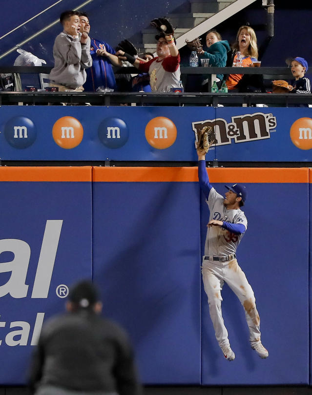 Los Angeles Dodgers center fielder Cody Bellinger leaps in vain for a home run hit by New York Mets' Jose Bautista during the eighth inning of a baseball game Saturday, June 23, 2018, in New York. The Dodgers won 8-3. (AP Photo/Julie Jacobson)