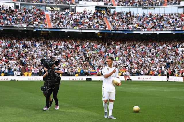 Eden Hazard walks onto the pitch during his official presentation at Real Madrid (AFP Photo/GABRIEL BOUYS )