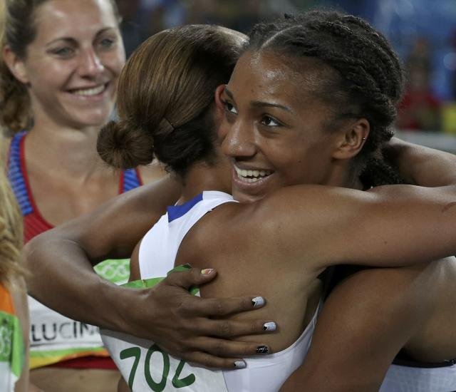 2016 Rio Olympics - Athletics - Final - Women's Heptathlon 800m - Olympic Stadium - Rio de Janeiro, Brazil - 13/08/2016. Gold medal winner Nafissatou Thiam (BEL) of Belgium (R) is embraced by silver medal winner Jessica Ennis-Hill (GBR) of Britain after the event. REUTERS/Phil Noble FOR EDITORIAL USE ONLY. NOT FOR SALE FOR MARKETING OR ADVERTISING CAMPAIGNS.