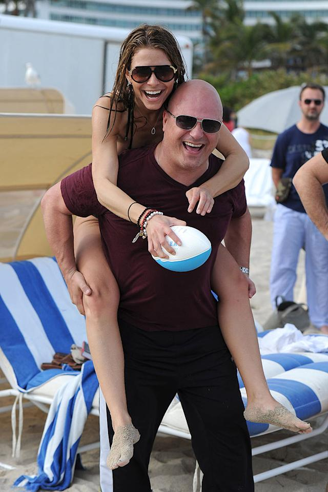 """""""Access Hollywood"""" correspondent Maria Menounos was snapped (interestingly enough) playing catch with """"No Ordinary Family"""" star Michael Chiklis in Miami. """"Beach football today w/@MichaelChiklis,"""" tweeted Menounos. """"Paparazzi had some fun! Hope the bikini shots are flattering! Scared!"""" Larry Marano/<a href=""""http://www.infdaily.com"""" target=""""new"""">INFDaily.com</a> - December 31, 2010"""