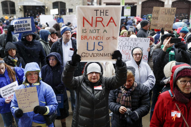 <p>Marilyn Schleyer, of Belleview, Ky., holds a sign as demonstrators gather during the March for Our Lives protest for gun legislation and school safety outside city hall in Cincinnati, Ohio. (Photo: AP/John Minchillo) </p>