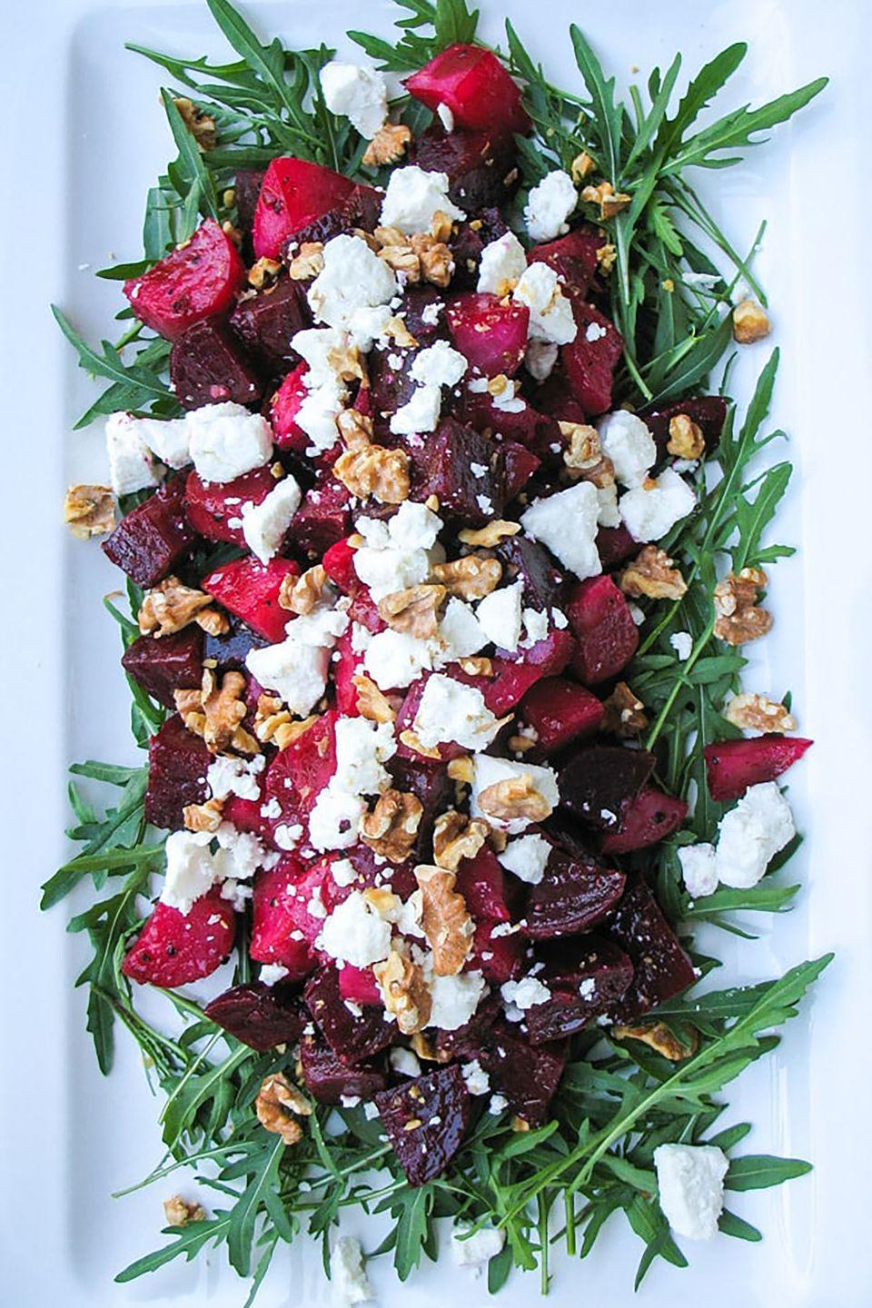 """<p>Add some color to your lunch spread with this healthy and vibrant salad. </p><p><strong>Get the recipe at <a href=""""http://thecookspyjamas.com/roasted-beetroot-goats-cheese-walnut-salad/"""" rel=""""nofollow noopener"""" target=""""_blank"""" data-ylk=""""slk:The Cook's Pyjamas"""" class=""""link rapid-noclick-resp"""">The Cook's Pyjamas</a>.</strong><br></p>"""