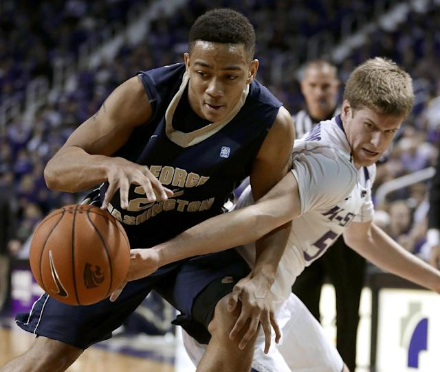 Kansas State's Will Spradling, right, tries to steal the ball from George Washington's Joe McDonald during the first half of an NCAA college basketball game Tuesday, Dec. 31, 2013, in Manhattan, Kan. (AP Photo/Charlie Riedel)